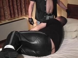 Tied gay dude sucking on lover\'s boner