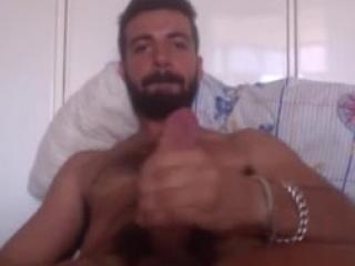 Horny jock playing with his boner