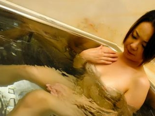 Naughty Asian girl fingers her pussy in the bathtu