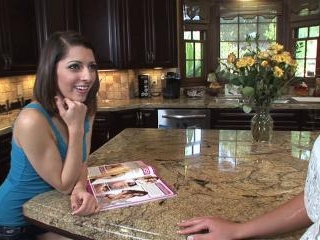 Lexi Bloom and Sally Charles on the kitchen island