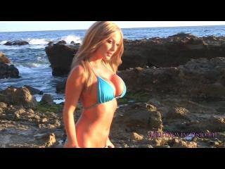 Sandi on the beach in a bikini