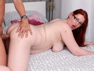 Curvy red haired cougar fucking and sucking her lo