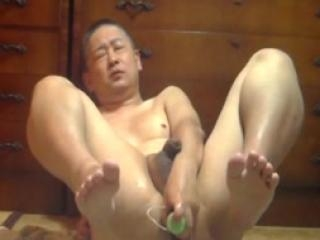Asian dude fucking his ass with a dildo