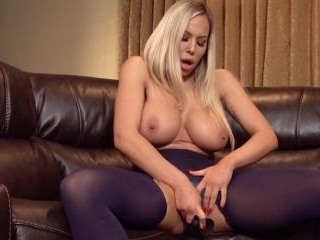 Olivia Austin plays with a big dildo