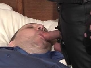 Bondage gay dude sucking on a dick