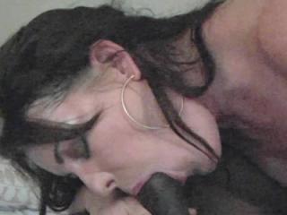Mature brunette Bella Roxx bounces on a big black