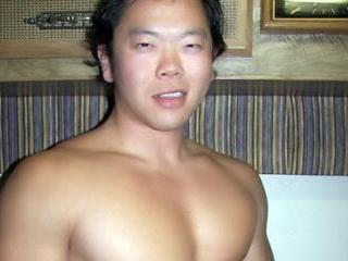 Beefy Asian camboy posing nude