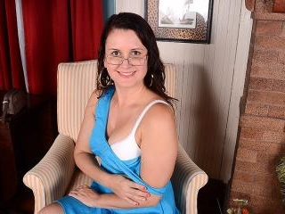 Horny American housewife playing with her shaved p