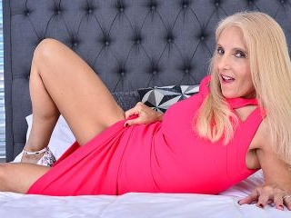 Mature Chery Leigh loves playing with her toys, an