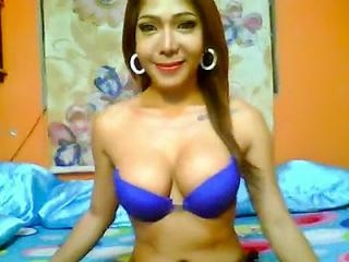 asianhugetits Playing With Her Rack