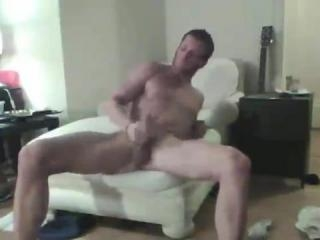 Bearded hunk plays with his hard cock