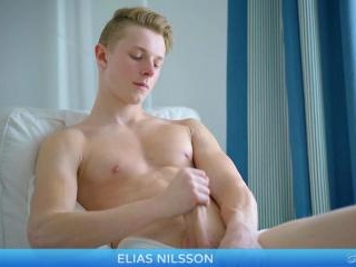 Sweet young fit twink Elias strokes a hot load out