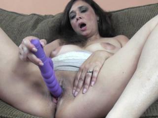 Mature brunette Alesia Pleasure list up her short