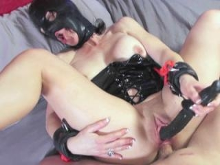 Kinky MILF Trixie in a black leather mask while sh