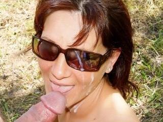 Brunette MILF gets cum on her glasses