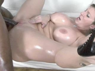 Busty MILF Sara Jay is covered in oil and taking a