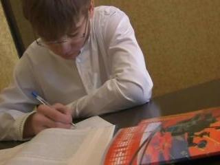 Blond teen doing homework