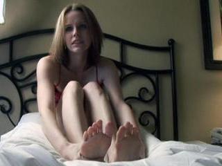 Beautiful brunette exposes her bare feet