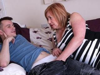Big breasted Auntie Trisha loves sucking cock