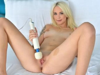 Luscious blonde uses a high voltage wand to reach
